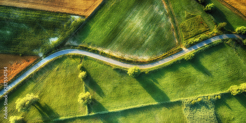 Drone aerial view - windy road in summer - fototapety na wymiar