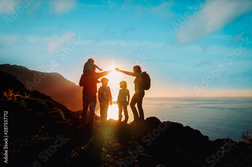 Fotografie, Obraz  happy family with kids travel in mountains at sunset