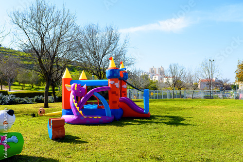 Fotografie, Obraz Inflatable castle outdoor at sunny summer day.