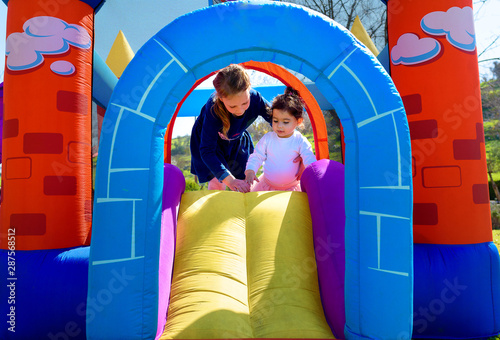 Fototapeta Inflatable castle outdoor at sunny summer day