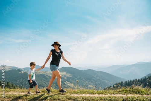 Young mom with baby boy travelling. Mother on hiking adventure with child, family trip in mountains. National Park. Hike with children. Active summer holidays. Fisheye lens