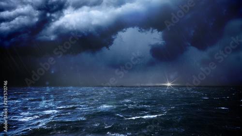 Vászonkép GERMANY, Sturm über dem Meer. Am Horizont ist ein Leuchtturm.