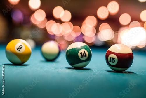 Obraz na plátně Colorful billiard balls on table close up