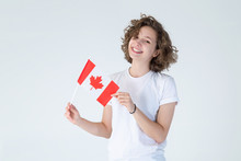 Happy Young Woman With The Flag Of Canada On A Light White Background. Portraits Canadian Student Female.