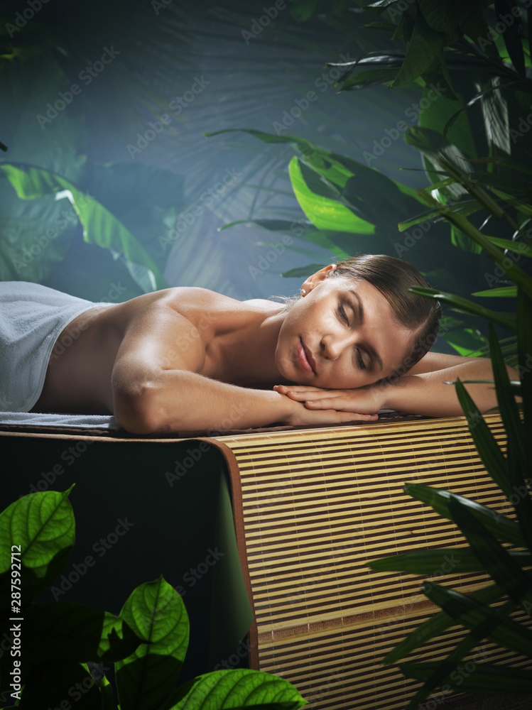 Fototapeta portrait of young beautiful woman in spa environment.