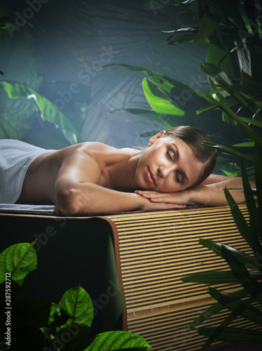 portrait of young beautiful woman in spa environment.   - 287592712