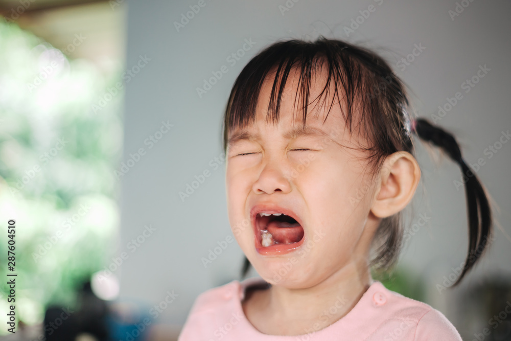 Fototapety, obrazy: Emotional picture of crying and screaming kid. Concept of terrible two behavior, anger and tantrum in children.