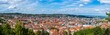 Leinwanddruck Bild - Germany, XXL panorama of city stuttgart downtown houses and church aerial view above the roofs with sun in summer