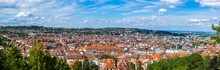 Germany, XXL Panorama Of City Stuttgart Downtown Houses And Church Aerial View Above The Roofs With Sun In Summer