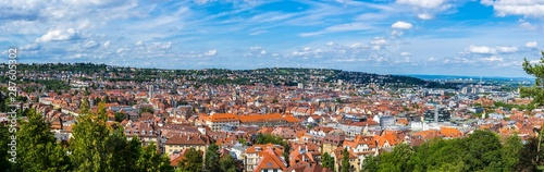 Fotobehang Panoramafoto s Germany, XXL panorama of city stuttgart downtown houses and church aerial view above the roofs with sun in summer