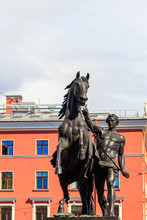 The Horse Tamers Sculpture On Anichkov Bridge In St. Petersburg, Russia
