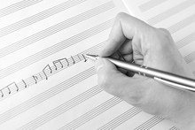 Hand Writing Music Notes Close...