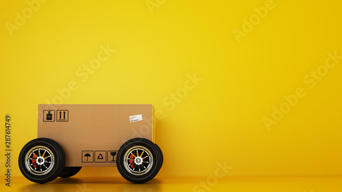Fotomural  Cardboard box with racing wheels like a car on a yellow background