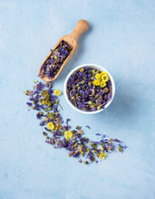 Aromatic Herbal Dry Tea Lavender And Chamomile Loose Near White Cup On Blue Wood Table