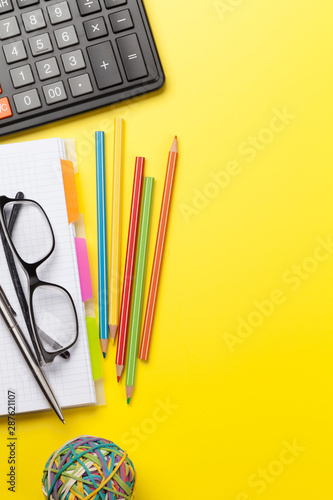 Office yellow backdrop with supplies and glasses - 287621107