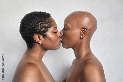 Valokuvatapetti Beautiful women kissing passionately while being naked