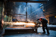 Leinwandbild Motiv Employee grinding steel with sparks - focus on grinder. Steel factory.