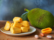 canvas print picture - Ripe jackfruit flesh on white plate on wooden table for tropical fruit or meat substitute concept.