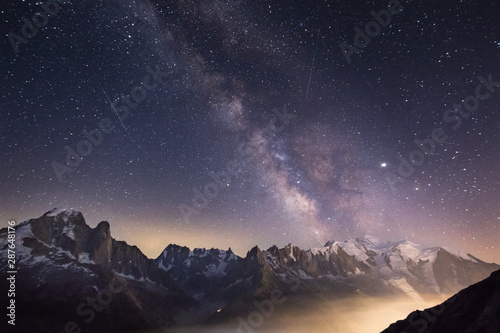 Obraz Milky way over the mountains - fototapety do salonu