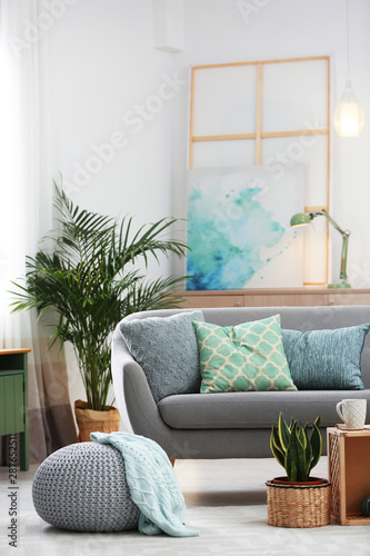Fototapeta Living room interior with green houseplants and sofa obraz