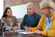 canvas print picture - Female notary working with mature couple in office