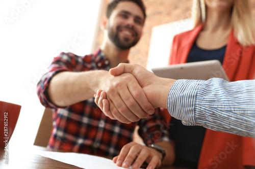 Business partners shaking hands after meeting, closeup Wallpaper Mural