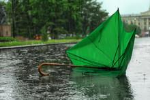 Broken Green Umbrella In Park ...