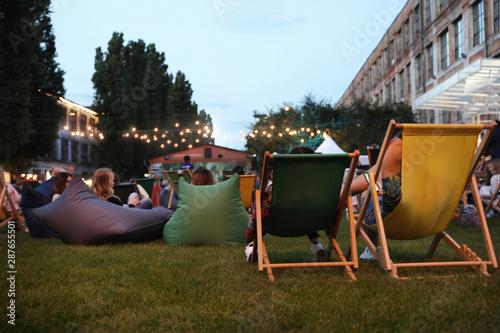 Carta da parati Modern open air cinema with comfortable seats in public park