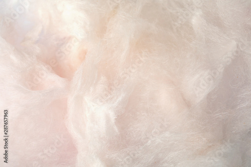Sweet light cotton candy as background, closeup view - 287657963