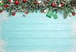 canvas print picture - Flat lay composition with fir branches, Christmas decoration and snow on light blue wooden background. Space for text