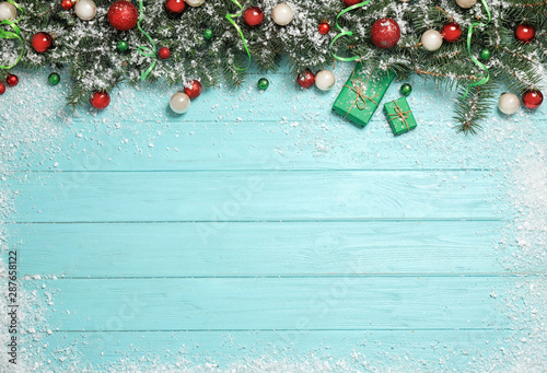 Door stickers Countryside Flat lay composition with fir branches, Christmas decoration and snow on light blue wooden background. Space for text