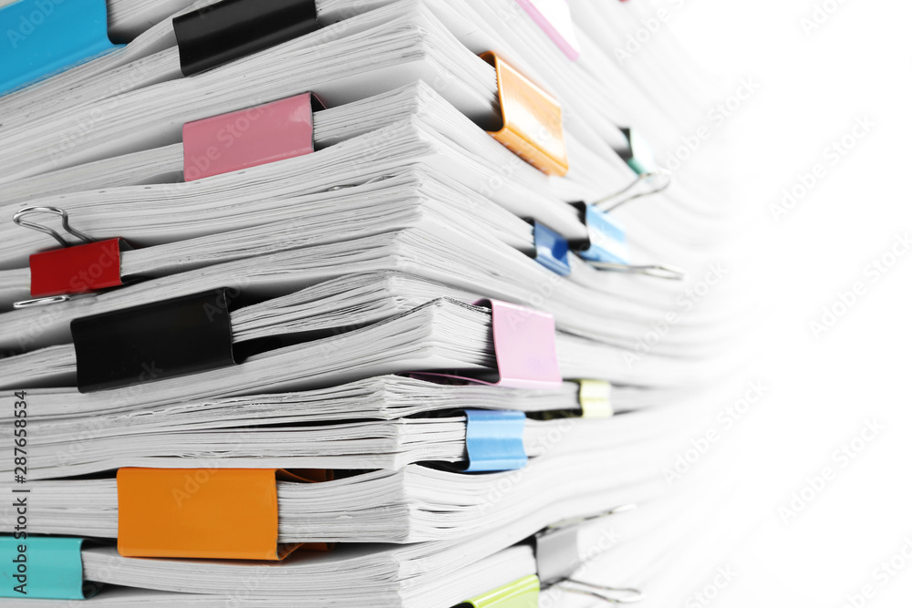 Fototapeta Stack of documents with colorful binder clips, closeup