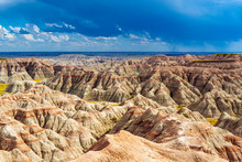 A Thunderstorm Inside Badlands National Park With The Rock Formations Illuminated By Sunlight, Rapid City, South Dakota, USA.