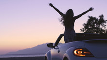 Young Woman In Cabriolet At Sunset