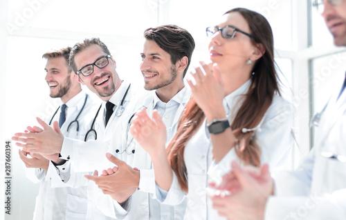 Valokuvatapetti group of successful doctors applauds