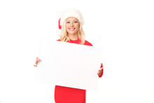 Cute Blonde Woman Wearing Santa Hat Is Posing With White Board.