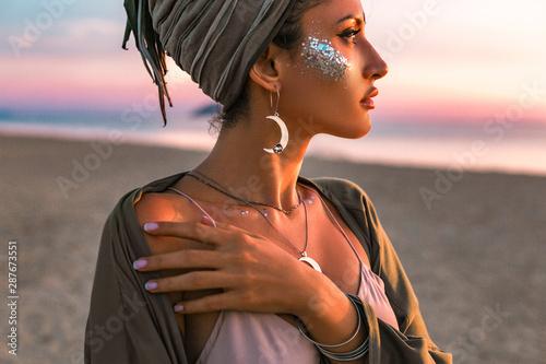 Obraz beautiful young fashion model on the beach at sunset portrait - fototapety do salonu