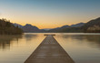 Stunning long pier on a lake in Austria with beautiful morning lights