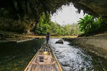 Man Drag Boat At Cave Lod Phenomenon Stone Stalactite And Stalagmite Of Natural,Pang Mapha,Mae Hong Son,Thailand