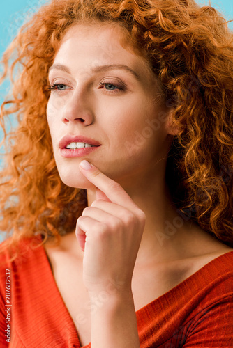 portrait of beautiful dreamy girl isolated on blue