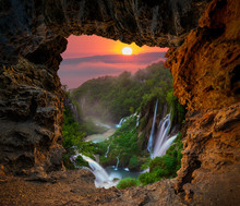 Waterfall In The Plitvice Lakes National Park Seen From A Natural Rock Cave