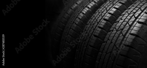 Canvastavla  Studio shot of a set of summer car tires on black background with copy space