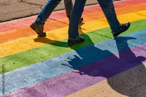 People walking on gay rainbow crosswalk in Montreal