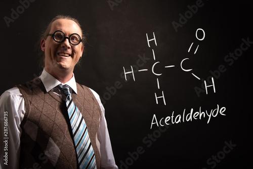 Photo Professor presenting handdrawn chemical formula of acetaldehyde molecule