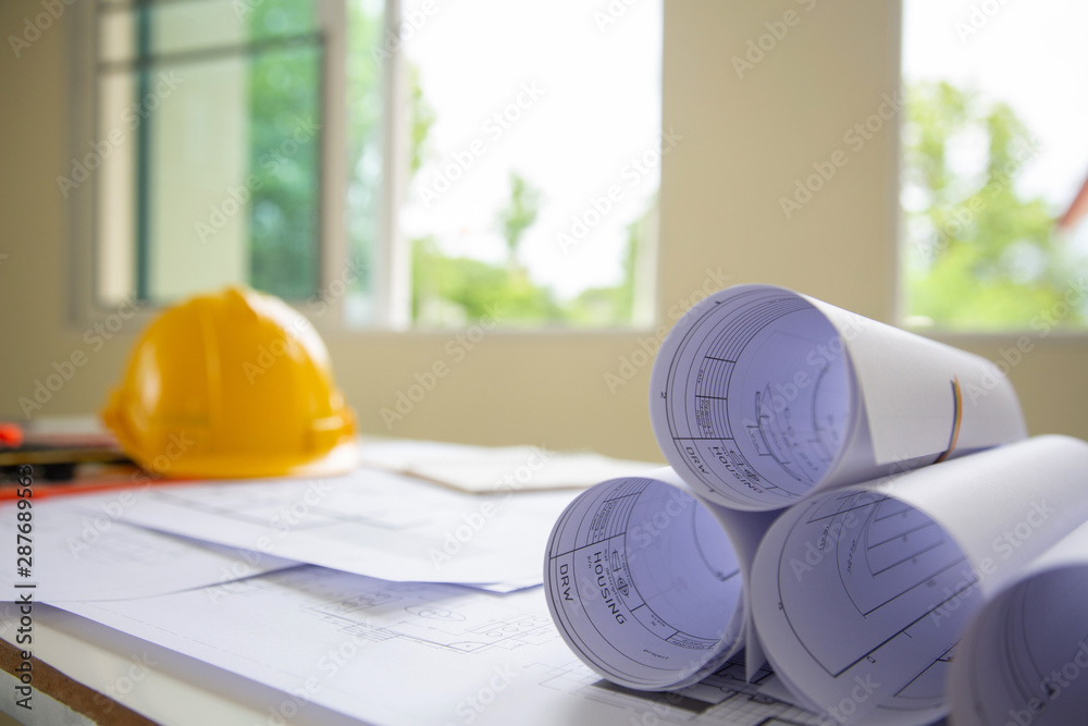 Fototapeta Engineers are writing home construction designs to bring them to prospective customers.