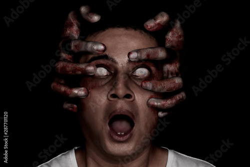 Young man possessed by devil Wallpaper Mural
