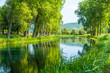 Beautiful Gacka river flowing between trees and fields, summer view, Lika region of Croatia