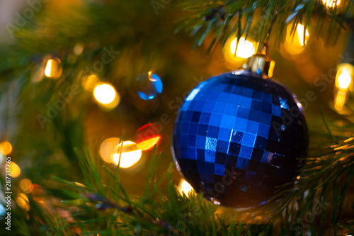 Macro photography of Christmas lights and ornaments on a Douglas fir tree Wallpaper Mural