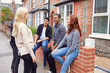 canvas print picture - Group Of College Students Outside Rented Shared House Talking And Laughing