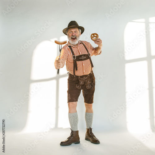 Vászonkép Portrait of Oktoberfest senior man in hat, wearing the traditional Bavarian clothes